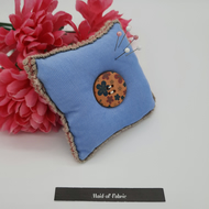 Pin cushion in blue with button, free uk delivery.