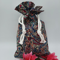 Wash bag in teal and cherry pattern fabric.