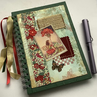 NOTEBOOK, journal ( lined ) , A5  ' Geranium Fairy ' . Red , green . Flower.