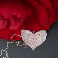 Heart pendant in etched sterling silver