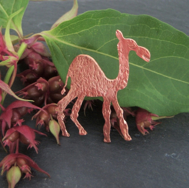 Camel brooch in copper