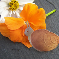 Snail brooch in copper and sterling silver