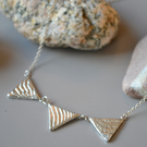 Triangle silver necklace, cuttlefish cast 3 triangle necklace, texture, tactile,
