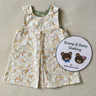 Age 6-9 months. Reversible pinafore dress