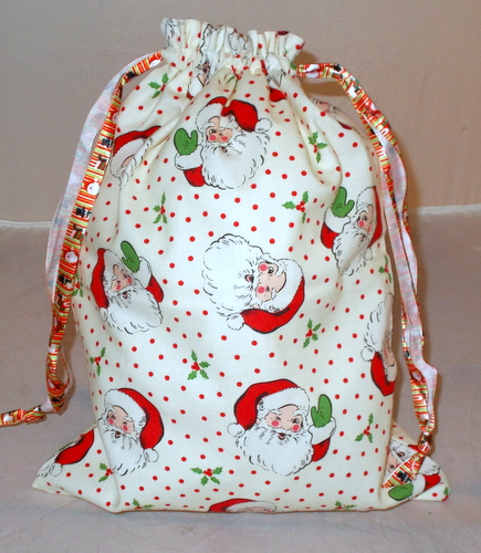 Christmas drawstring bag printed with Santa's face.