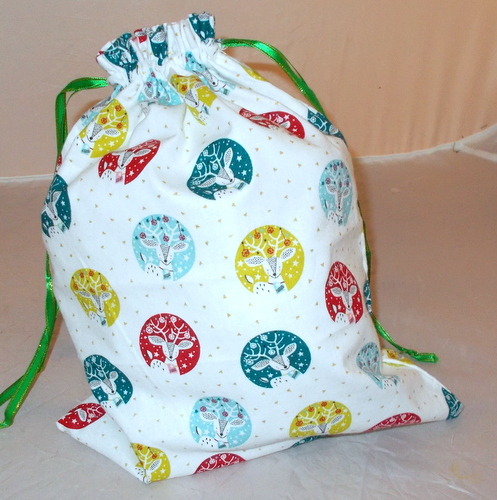 Christmas drawstring bag with printed stag heads.