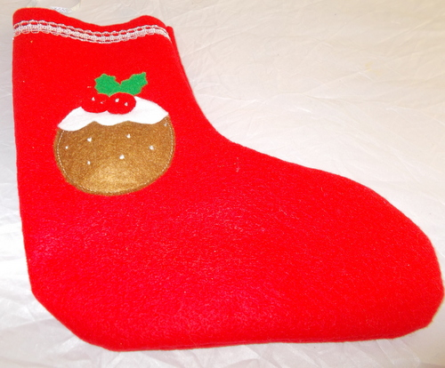 Hand made red felt Christmas stockings with Christmas pudding