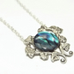 Antique Style Morning Glory Pendant With Blue Ablone Cabochon.