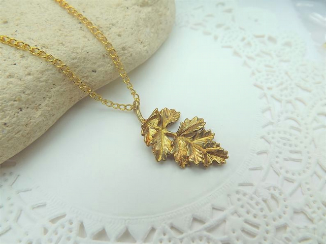 Frilly Ash Leaf Charm Necklace in Gold Plate