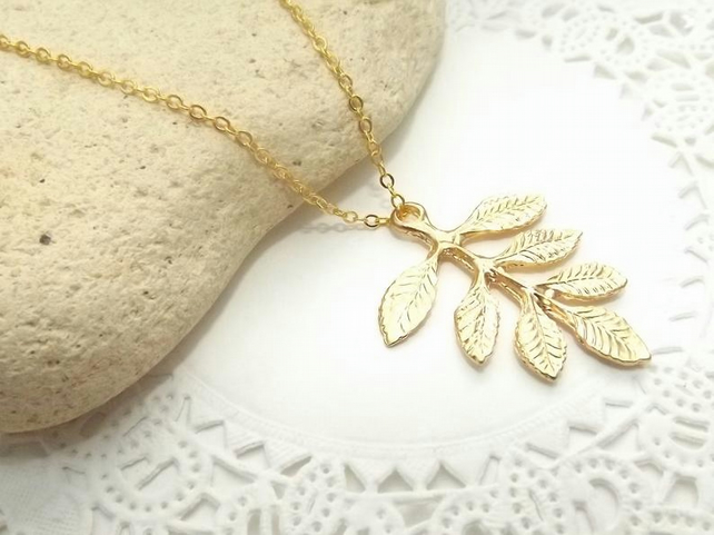 Ash Leaf Charm Necklace in 14k Matt Gold Plate.