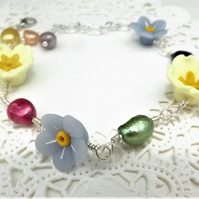 Forget Me Knot and Primrose Flower, yellow and blue bracelet with Rainbow Pearls