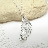 Silver Feather Charm Necklace.  Silver Plated Pendant.