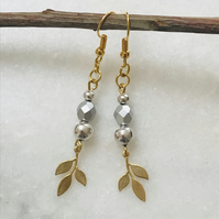 Pretty gold and silver dangle earrings with gold leaf charms