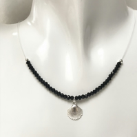 Black onyx gemstone bead necklace with sterling silver shell charm