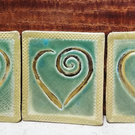 Golden heart decorated ceramic coasters