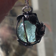 Silver caged aqua marble