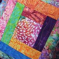 Quilted Cushion in Colourful Batik Fabrics