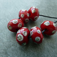 red and ivory spots lampwork glass beads