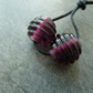 purple ribbed lampwork glass beads