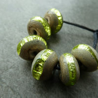 green sparkly wrapped lampwork glass beads