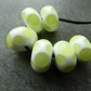 white and green spot lampwork glass beads