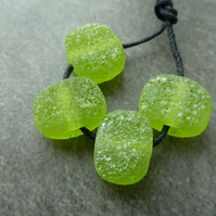green pitted lampwork glass beads