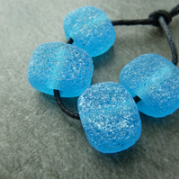 blue pitted lampwork glass beads