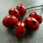 red and black spots lampwork glass beads