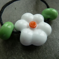 white flower lampwork glass bead