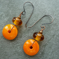 copper earrings, orange lampwork discs