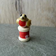 wooden spool with robin