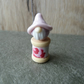 wooden spool with pink gnome