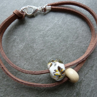 faux suede bracelet, ivory glass beads