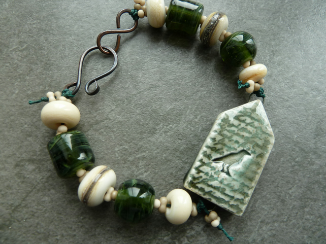 copper, green lampwork glass, ceramic raven bracelet