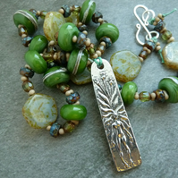 pewter mandrake and green lampwork glass necklace