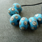 handmade lampwork glass beads, blue and ivory spots