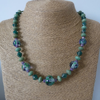 purple and green lampwork glass necklace