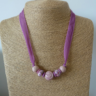 purple silk necklace, ceramic rose, lampwork glass beads