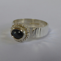 Blue Sapphire cabochon set in sterling silver on Argentium silver ring size O