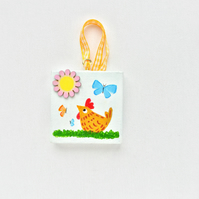 Hand painted miniature canvas Cheeky chicken.