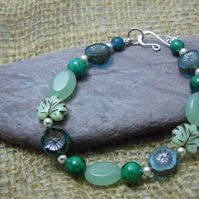 A handmade Sterling Silver bracelet with semi-precious Chrysocolla beads