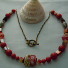A shell, faux coral beads, Lampwork bead & Czech glass bead necklace