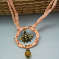 A necklace pendant copper ring, bee charm & crystal