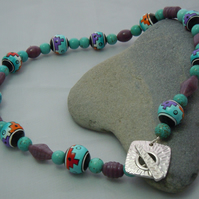 A necklace of Peruvian handpainted beads, glass & Magnesite beads