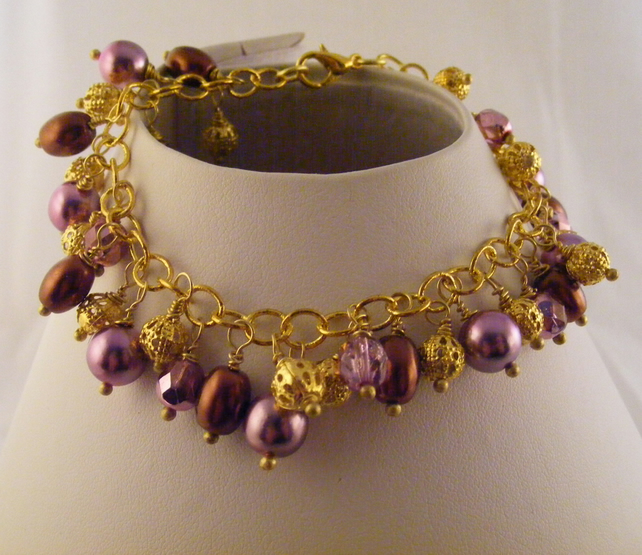 Brown, Pink and Gold Charm Bracelet.
