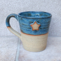 Coffee mug tea cup with a star in stoneware hand thrown pottery ceramic