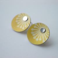 Yellow stud earrings with starburst print