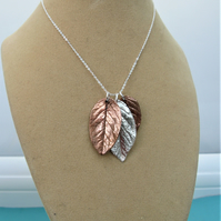 Silver and copper triple leaf necklace