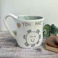 Giant size.Handmade porcelain mug, sunshine and bee with button detail.