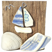 Sailing Boat on Driftwood. Beach Pottery Yacht, Shell Pebble Art Wooden Ornament